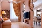 крепленеи телевизора в гостинной