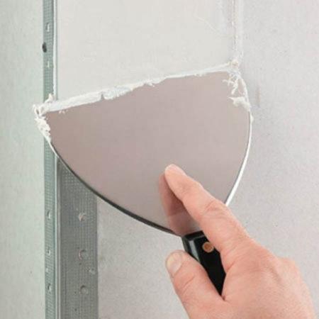 Шпаклевка гипсокартонной поверхности в месте стыковки стен